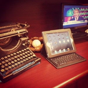 typewriter, iPad and television
